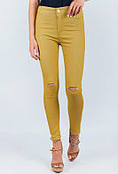 Стильные зауженные брюки с разрезами на коленях