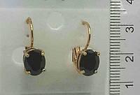 Классические золотые серьги с черными овальными камнями .143