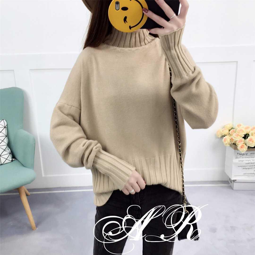 Женский свитер с высоким горлом