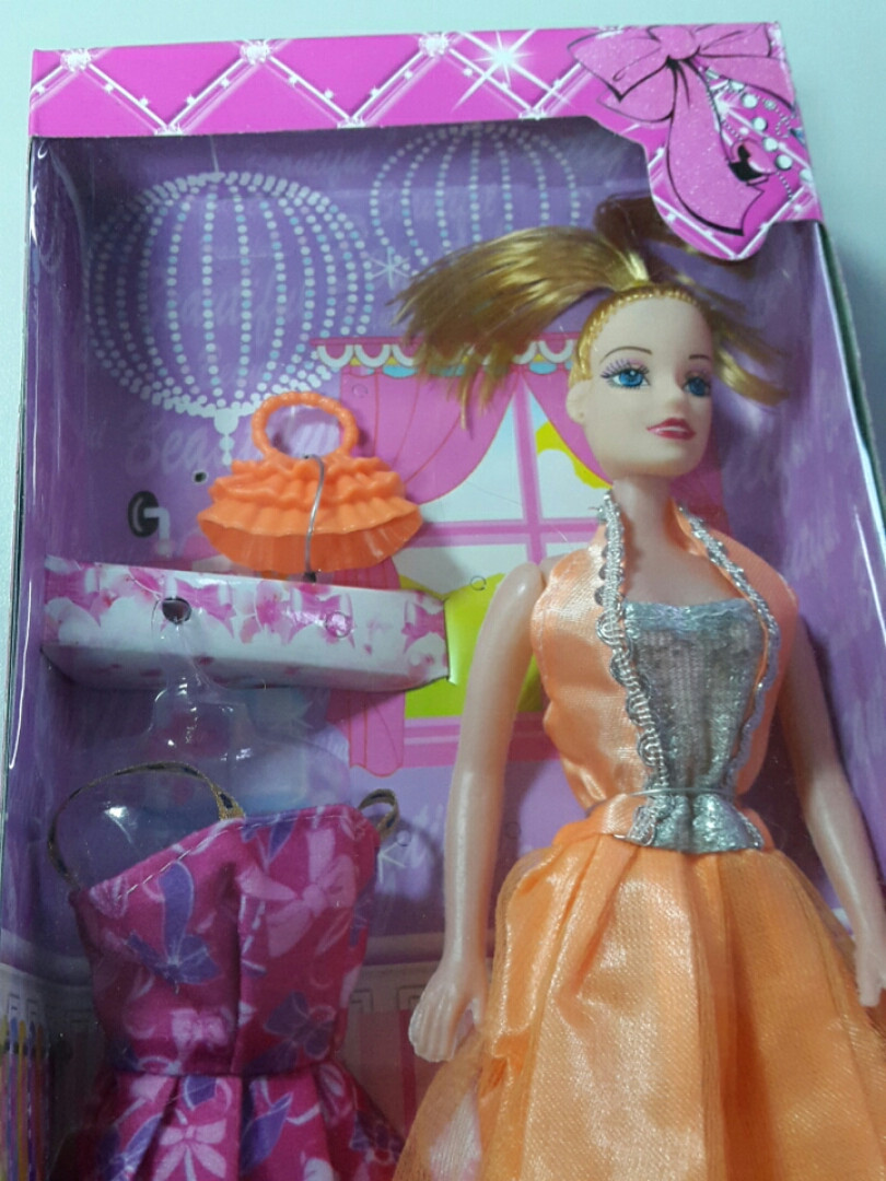 Кукла в наборе в оранжевом платье