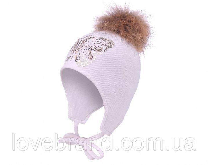 Зимняя шапочка для девочки на завязку с натуральным помпоном енот