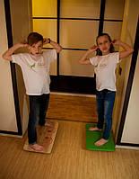 Упражнение на балансировочной доске