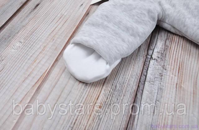 комбинезон имеет отвороты-рукавички