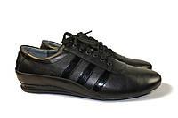Кожаные кроссовки с лаковыми вставками