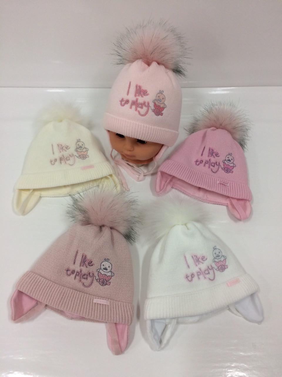 Детские утеплённые вязаные шапки оптом с завязками и помпоном для девочек, р.38-40, Grans (Польша)