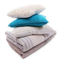 Пледы и подушки декоративные