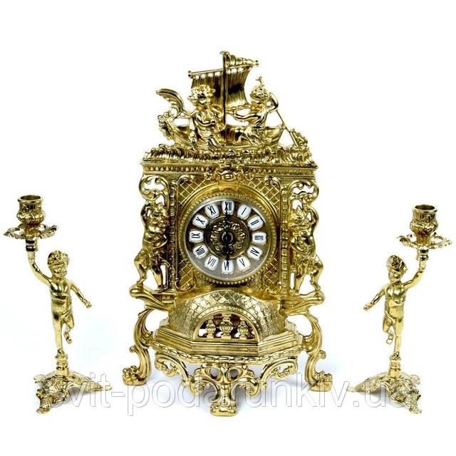 каминные часы и подсвечники