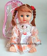 Кукла говорящая,рус.язык,25 см,фразы,песня,в рюкзачке