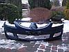 Бампер передний на Mitsubishi Lancer 9 2003-2006 код MN126451