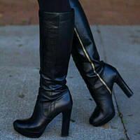 На высоте с Мариго: кожаные сапоги на каблуке и актуальные тенденции