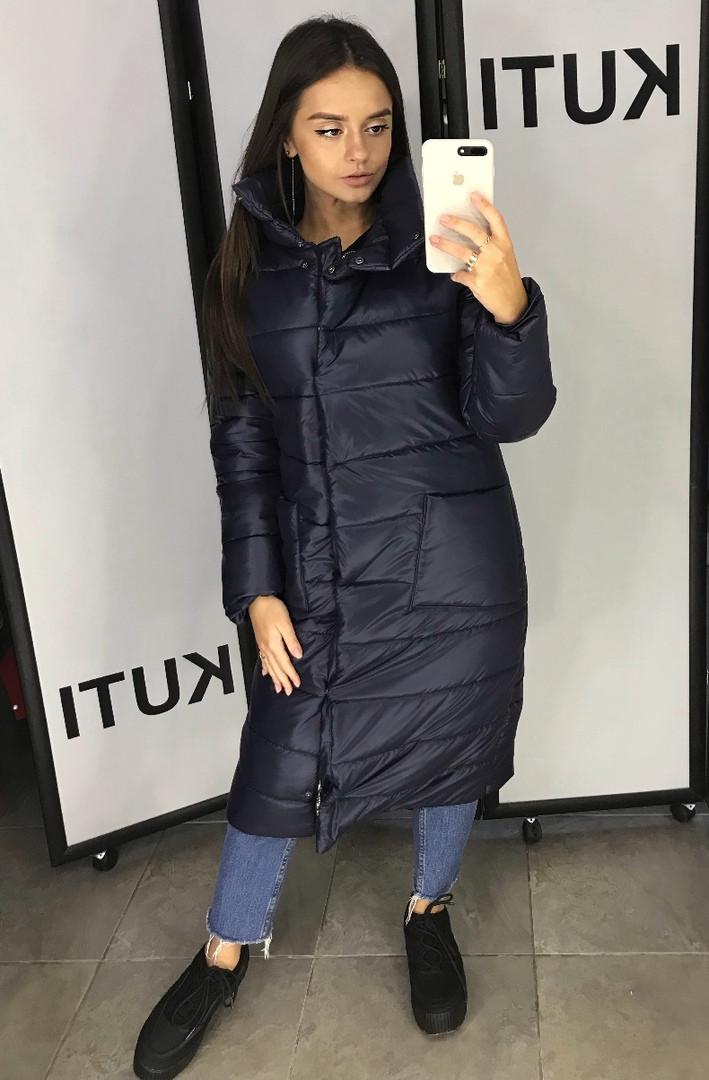 Женское пальто на кнопках