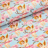 Хлопковая ткань Амуры на голубом фоне