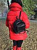 Женский рюкзак из натуральной кожи чёрного цвета с одним основным отделением и четырьмя наружными карманами