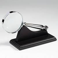LUWO2 Лупа 4х63, стекло, металлический корпус, хромированная, на черной подставке
