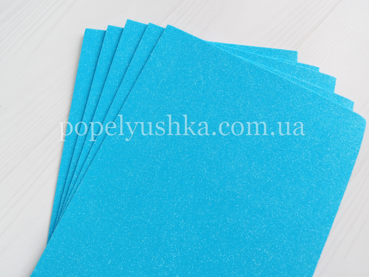 Фоам 2 мм 30*20 см з глітером голубий