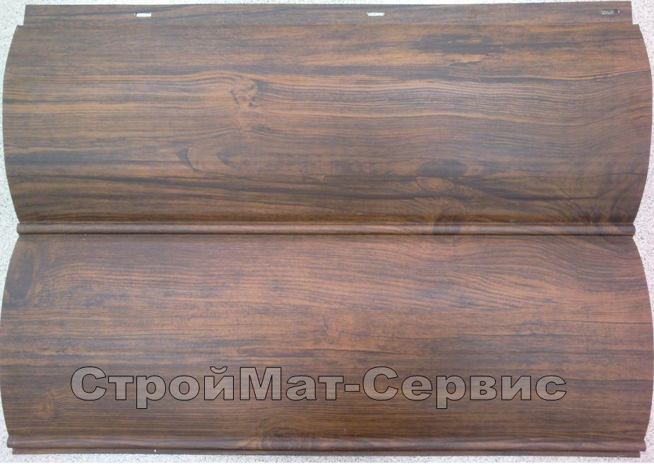 """Для ограждения были использованы двухпереломные панели металлического сайдинга """"полубрус, шириной 340мм. Изготовлен металлосайдинг из металла толщиной 0,5мм, производства Dongbu Steel с принтом породы дерева  """"орех""""."""