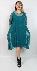 Вечернее женское платье декорированное сеткой с бусинами