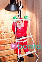 Новогодний декор Bonita Дед Мороз 50 см на лестнице