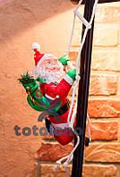 Хит! Игрушка декоративная Санта Клауса 20 см лезет по лестнице на балкон