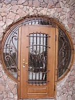 Двери со стеклопакетами и ковкой