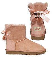 Женские кожаные угги с меховыми кисточками  UGG розовые (реплика)