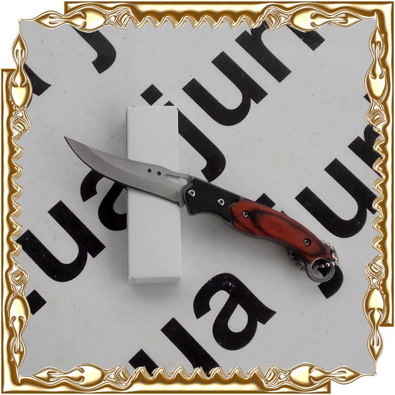 Нож складной, ручка под дерево с цепочкой. Нож -- 155 мм. NK101