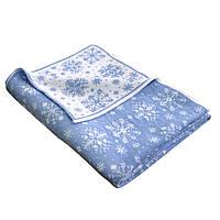Плед вязаный снежинки бело-голубой