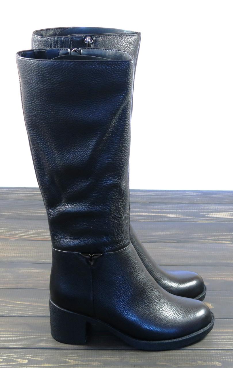 Кожаные зимние сапоги на каблуке женские