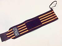 Напульсник эластичный для фиксации запястья черный/оранжевый с петлей