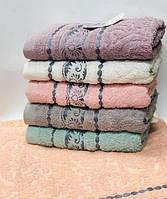 Полотенца махровые с узором