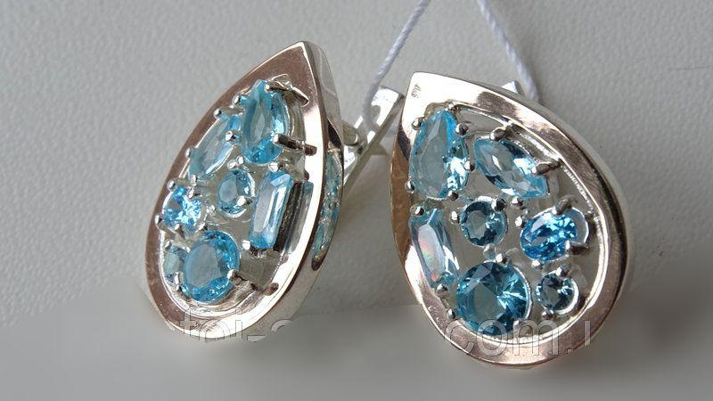 Уникальные серебряные серьги с золотыми пластинками и голубыми фианитами