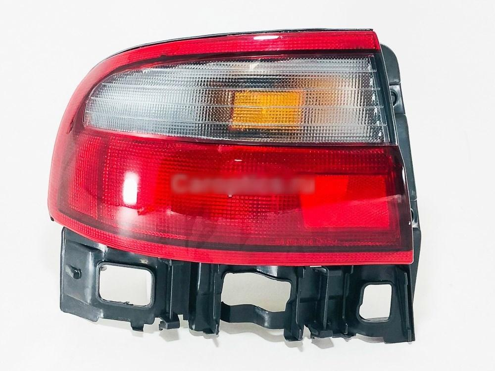 Фонарь левый Toyota Carina E 92-97 (Depo)