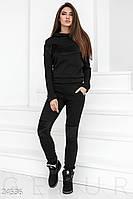 Женский теплый спортивный костюм черного цвета
