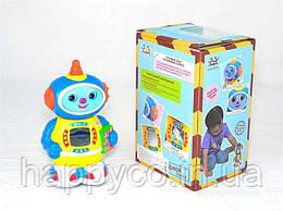 Детская игрушка робот Космический доктор  песня на англ. языке, подсветка, движение от батареек, свет