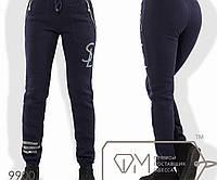 56b493ce Спортивные штаны из трикотажа на флисе с манжетами, карманами-карго на  молниях и логотипом