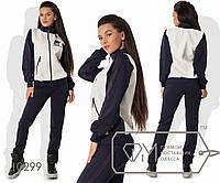 Спорткостюм из двунитки - олимпийка на основе стёганой экокожи с  воротом-стойкой и полосами на 83017500137