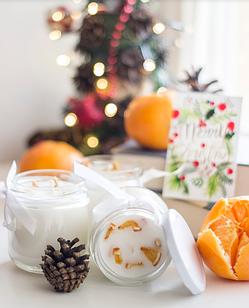 Ароматизована свічка в банці з апельсином