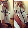 Стильное платье средней длинны на основе трикотажа