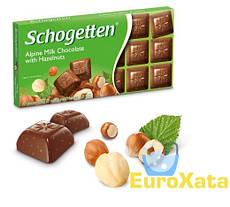 Шоколад Schogetten Alpine Milk with Hazelnuts молочный с орешками 100 гр