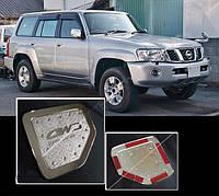 Накладка на лючок бензобака Nissan Patrol Y61 1997-2011 (ABS-пласт.) Carmos