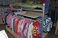 Островной стеллаж для одежды. Стеллажи для детских магазинов.  WIKO (ВИКО). оборудование для магазина одежды