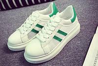 Зеленые кроссовки с сеткой