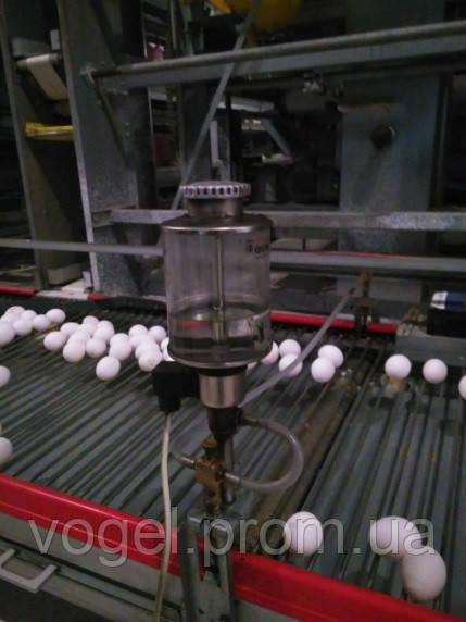 Система змазки мастилом стрічки пруткової яйцесбору