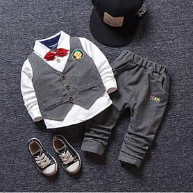 Нарядный костюм тройка на мальчика с жилеткой и бабочкой серый  3-4 года