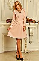 Пудровое платье с оригинальным вырезом горловины