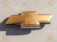 Эмблема решетки Шевроле Авео, Aveo, Lacetti Лачетти (пр-во GROG Корея) на скотче. Габариты: 130х46мм ПИР 52496