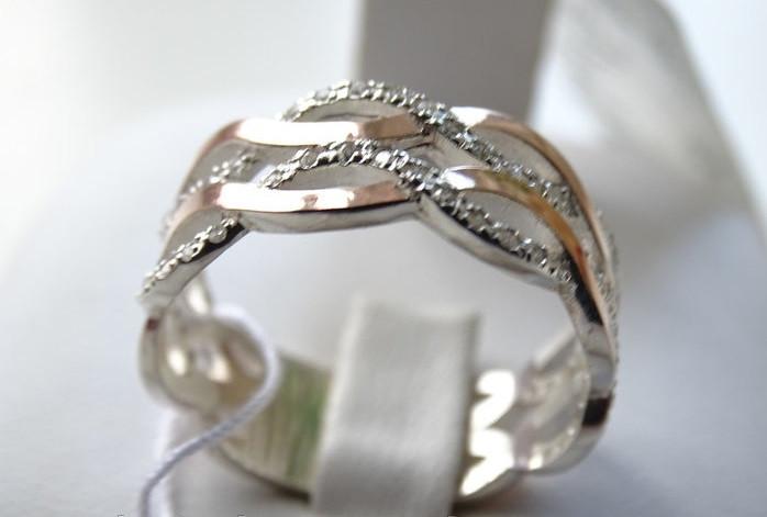 Жіноче срібне кільце з золотими вставками