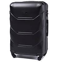 Большой пластиковый чемодан Wings 147 на 4 колесах черный