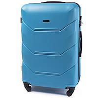 Средний пластиковый чемодан Wings 147 на 4 колесах голубой