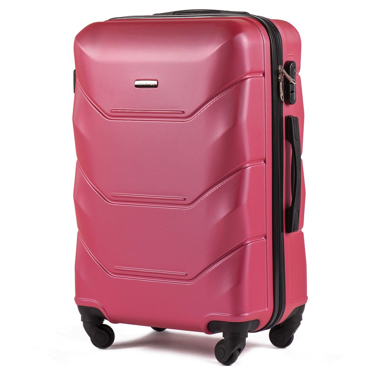 Средний пластиковый чемодан Wings 147 на 4 колесах розовый